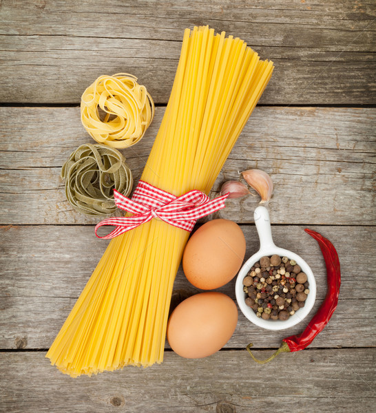 Pasta, eggs and spices Stock photo © karandaev