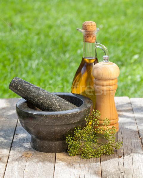 Olive oil bottle, pepper shaker and mortar Stock photo © karandaev