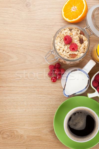 Kahvaltı müsli karpuzu portakal suyu kahve kruvasan Stok fotoğraf © karandaev