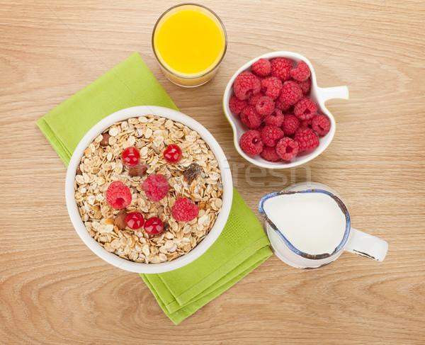 Healty breakfast with muesli, berries, milk and orange juice Stock photo © karandaev