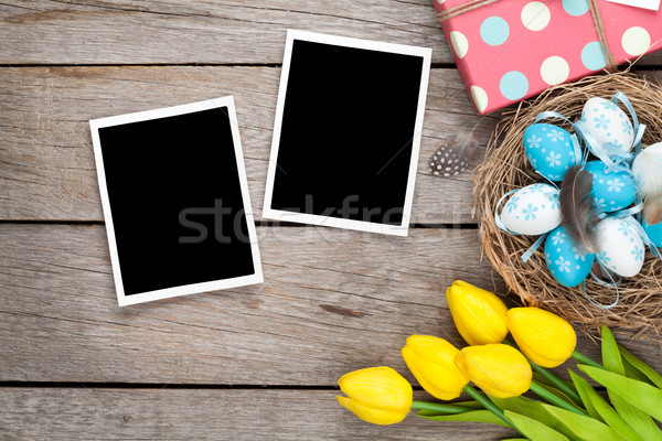 Easter background with blank photo frames, blue and white eggs,  Stock photo © karandaev