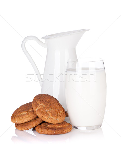 Milk jug, glass and cookies Stock photo © karandaev