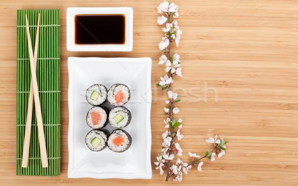 Sushi maki set with fresh sakura branch Stock photo © karandaev