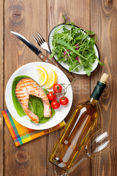 Grilled salmon and white wine on wooden table Stock photo © karandaev