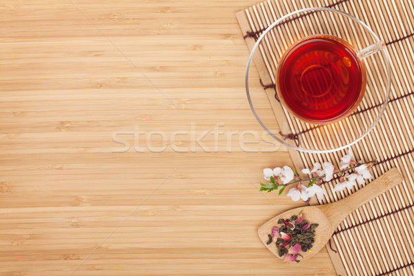 Japanese green tea and sakura branch over mat Stock photo © karandaev