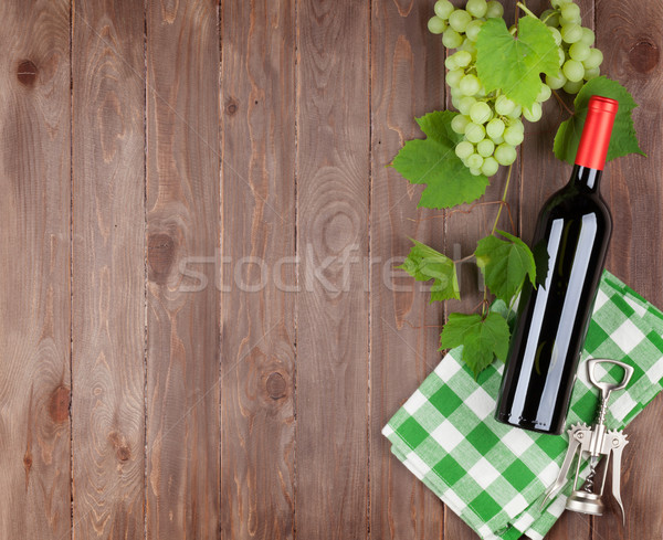 Bunch of grapes, red wine bottle Stock photo © karandaev