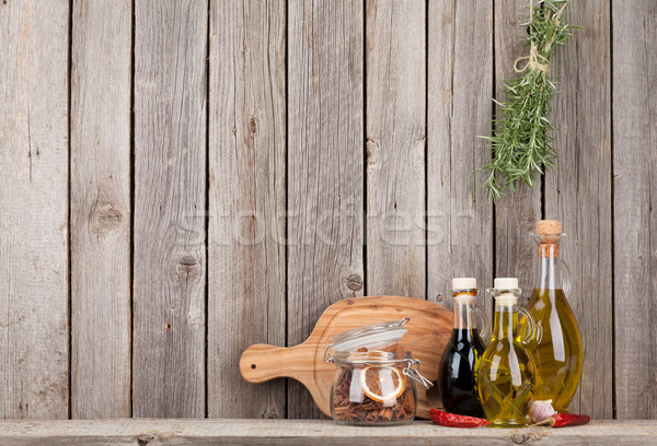 Stock photo: Kitchen utensils, herbs and spices on shelf