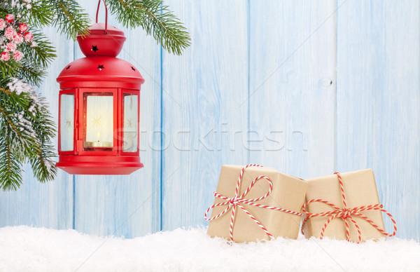 Christmas candle lantern, gift boxes and fir tree Stock photo © karandaev