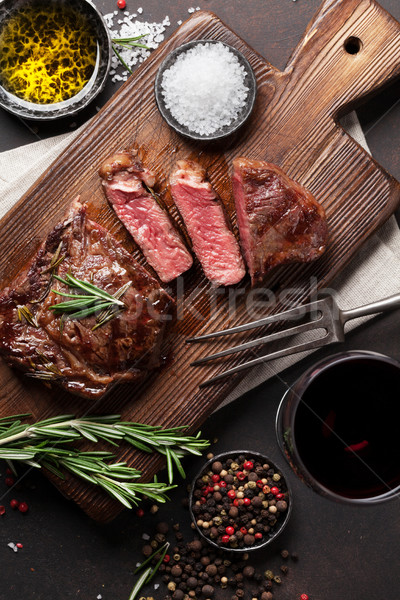 Grilled ribeye beef steak with red wine Stock photo © karandaev