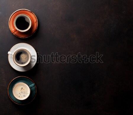 Tazze di caffè vecchio tavolo da cucina top view copia spazio Foto d'archivio © karandaev