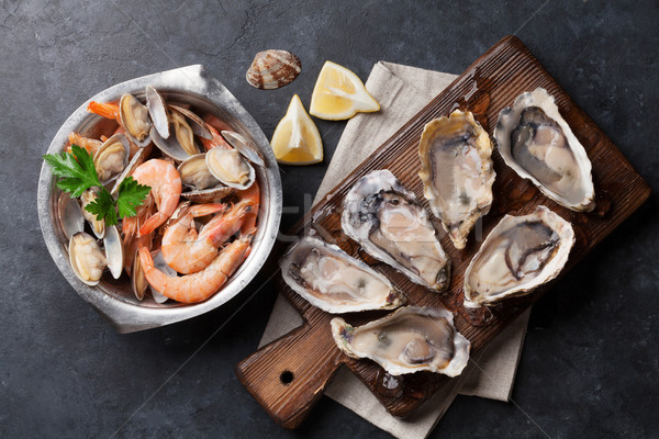 Stock photo: Fresh seafood. Scallops, oysters and shrimps