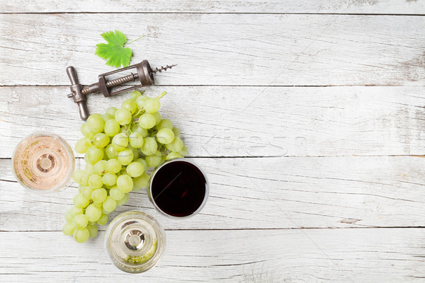Wine glasses and grapes Stock photo © karandaev