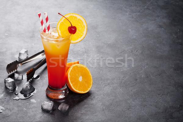 Tequila napfelkelte koktél sötét kő asztal Stock fotó © karandaev