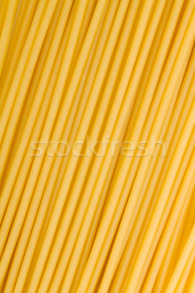 Spaghettis pâtes fond couleur jaune Photo stock © karandaev