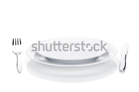 Silverware or flatware set of fork, knife and plates Stock photo © karandaev