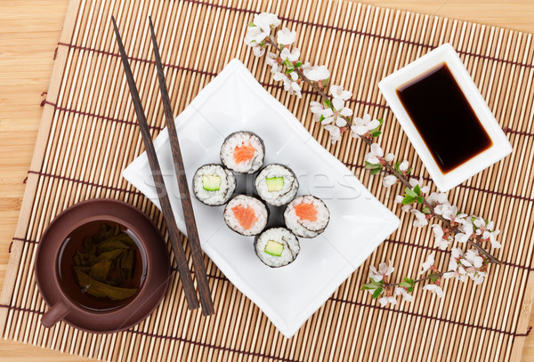 Sushi maki set with salmon and cucumber and green tea Stock photo © karandaev