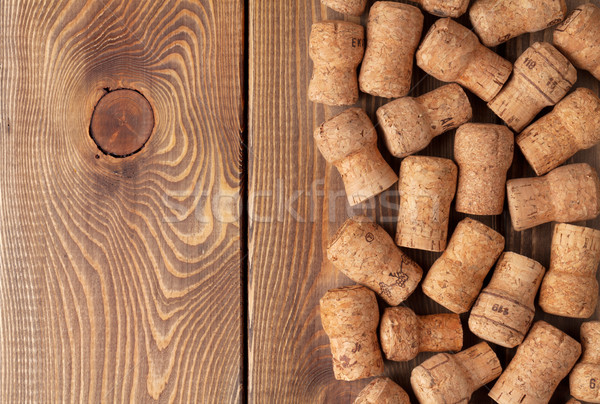 Champagne wine corks over wooden table Stock photo © karandaev