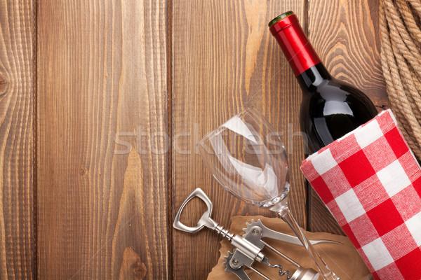 Red wine bottle, wine glass and corkscrew Stock photo © karandaev