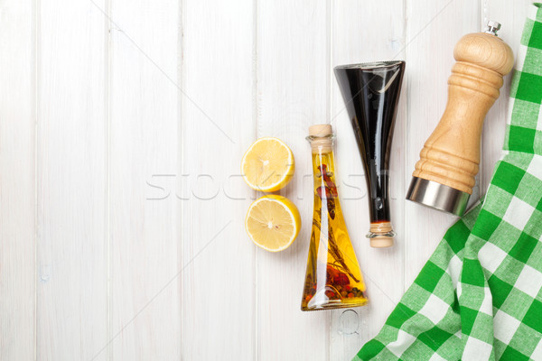 Condiments and spices over white wooden table Stock photo © karandaev