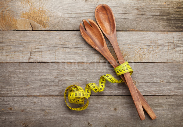 Measure tape with kitchen utensils. Diet food Stock photo © karandaev