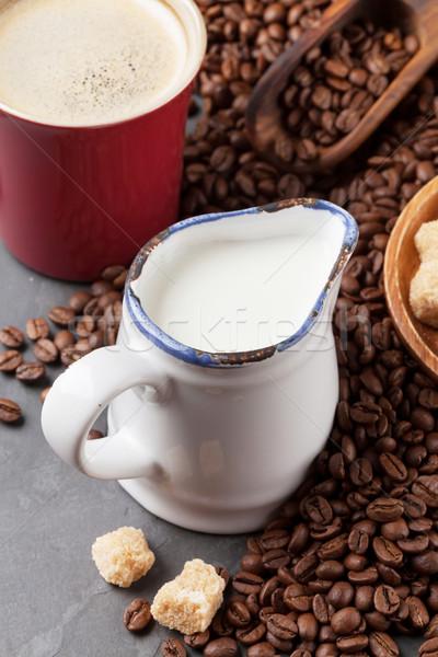 Tejesflakon kávéscsésze bab kő asztal textúra Stock fotó © karandaev