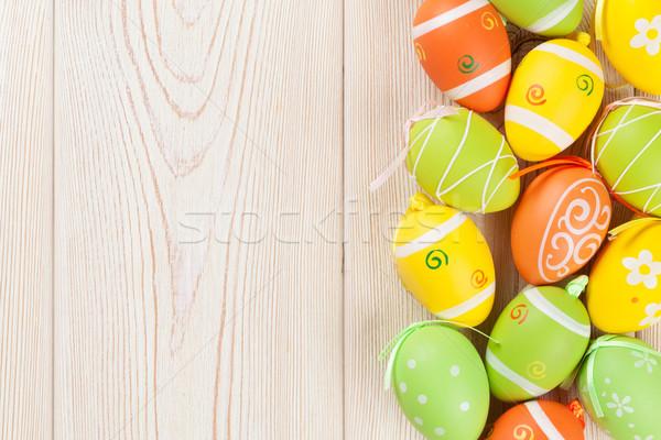 Húsvét színes tojások fa asztal felső kilátás Stock fotó © karandaev