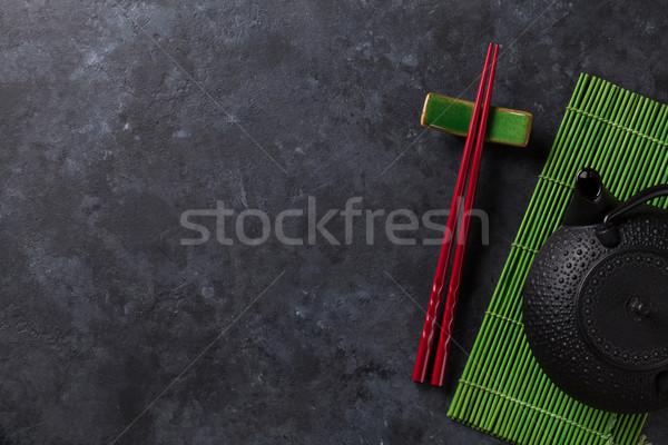Zöld tea szusi evőpálcikák kő asztal felső Stock fotó © karandaev