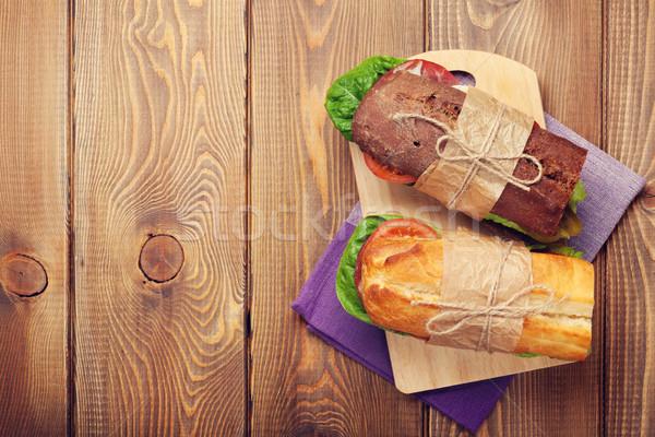 Deux sandwiches salade jambon fromages tomates Photo stock © karandaev