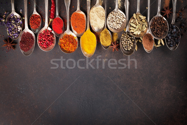 Various spices spoons on stone table. Top view Stock photo © karandaev