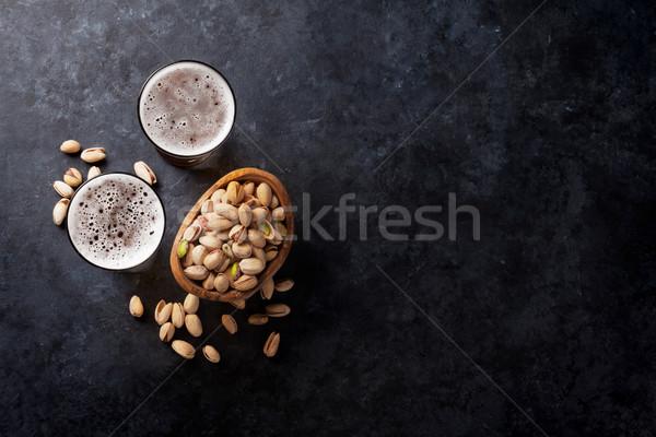 Bière collations pierre table noix Photo stock © karandaev