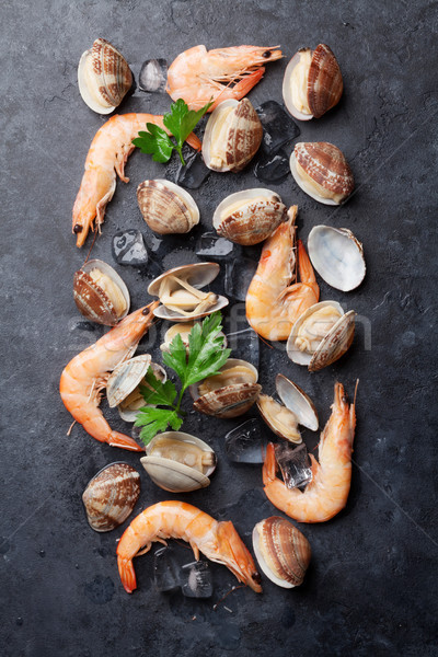Stock photo: Fresh seafood on stone table