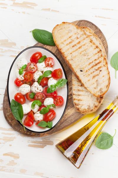 Caprese bruschetta pişirme kiraz domates mozzarella fesleğen Stok fotoğraf © karandaev