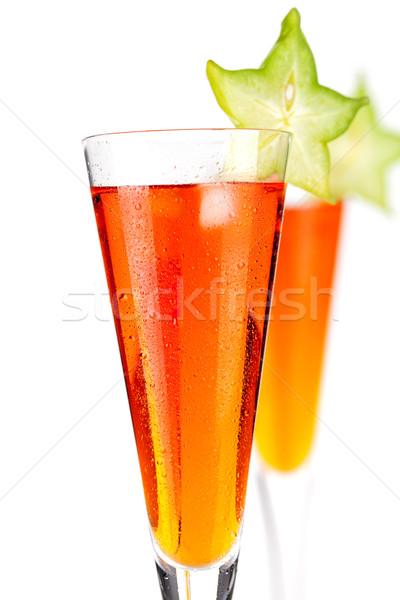 Orange alcohol cocktail with carambola Stock photo © karandaev