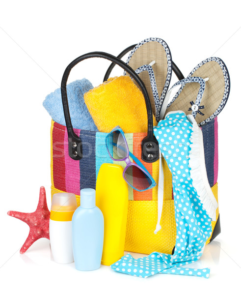 Bag with towels, sunglasses, flip-flops and beach items Stock photo © karandaev