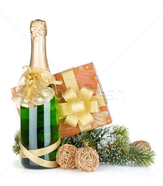 Champagne bottle, christmas gift and snowy firtree Stock photo © karandaev