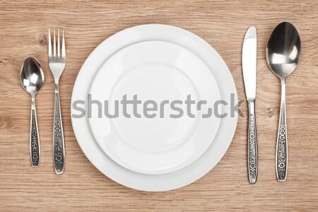 空っぽ プレート 銀食器 セット 木製のテーブル 食品 ストックフォト © karandaev