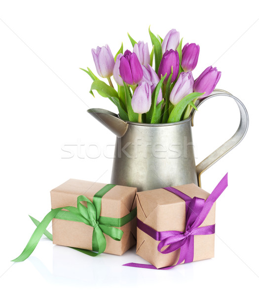 Purple tulip bouquet in watering can and gifts Stock photo © karandaev