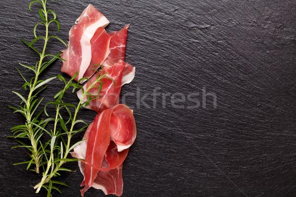 Prosciutto rozmaring kő asztal felső kilátás Stock fotó © karandaev