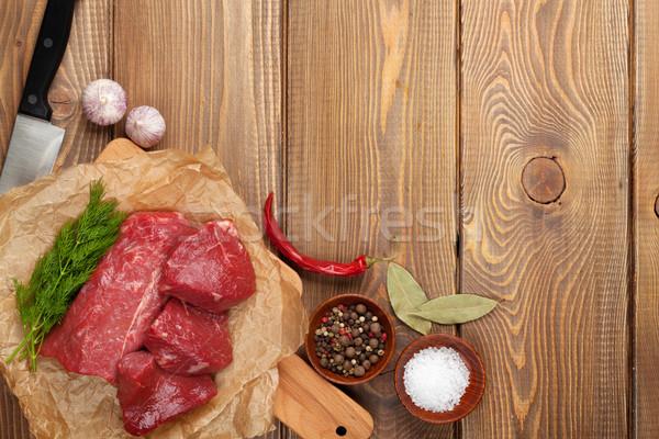 Nyers filé bifsztek fűszer fa asztal felső Stock fotó © karandaev