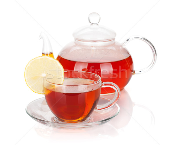 Glass teapot and cup of black tea with lemon slice Stock photo © karandaev