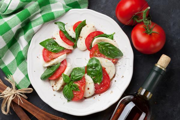 Mozzarella cheese, tomato and basil. Caprese Stock photo © karandaev
