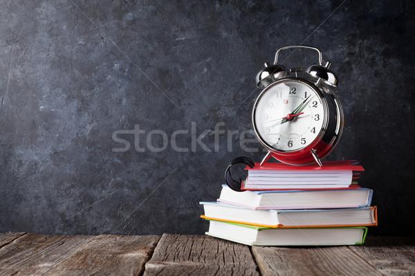 Alarm clock on notepads in front of chalk boad Stock photo © karandaev