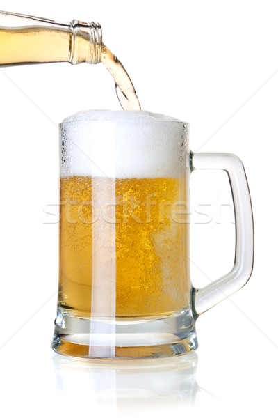 Beer is pouring into a glass from bottle Stock photo © karandaev