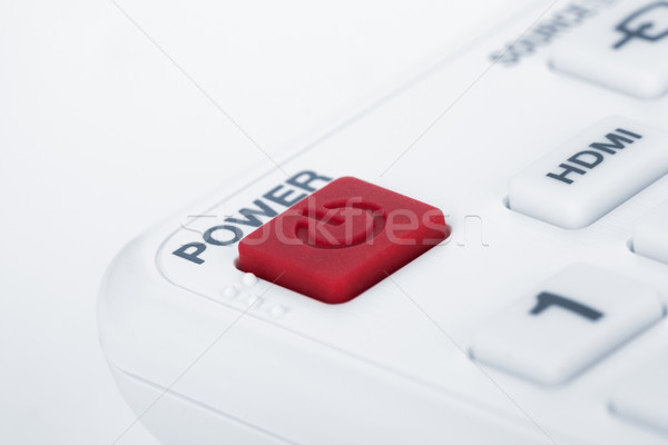 Remote control closeup. Focus on POWER button Stock photo © karandaev