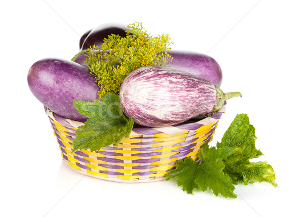 Fresh ripe eggplants in basket Stock photo © karandaev