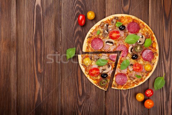 итальянский пиццы пепперони помидоров оливками базилик Сток-фото © karandaev