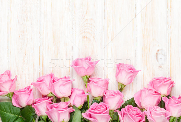 Rose roses bouquet table en bois haut vue Photo stock © karandaev