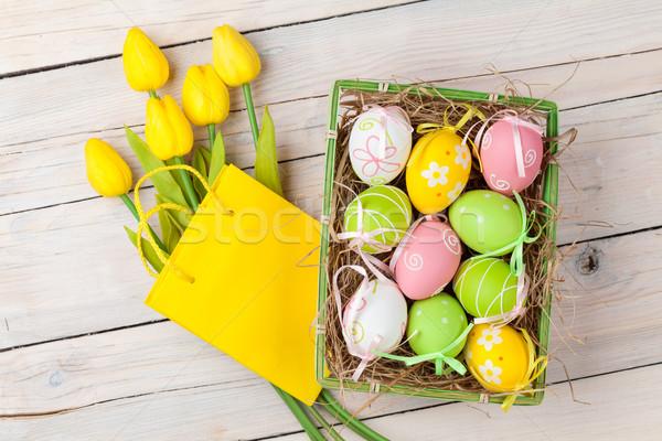 Paskalya renkli yumurta sarı lale beyaz Stok fotoğraf © karandaev
