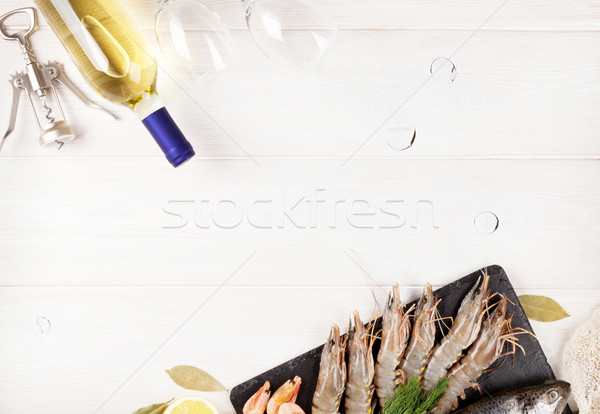Fresh raw sea food with spices and white wine bottle Stock photo © karandaev