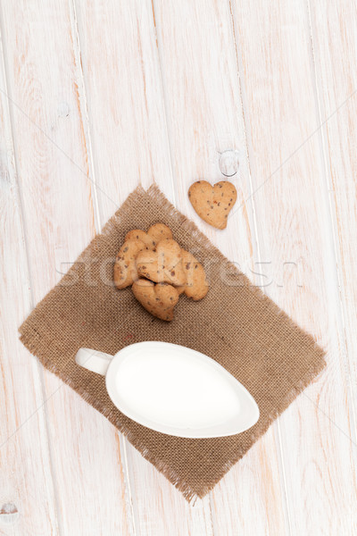 Heart shaped gingerbread cookies and milk pitcher Stock photo © karandaev